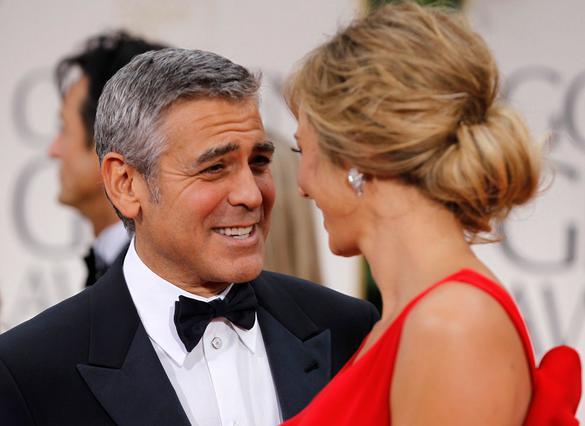 Ο Κλούνεϊ με τη αγαπημένη του Στάισι Κίμπλερ στις Χρυσές Σφαίρες 2012. Πρόσεχε τι λες Τζορτζ: μην ξεχνάς ότι το κορίτσι είναι παλεστής!