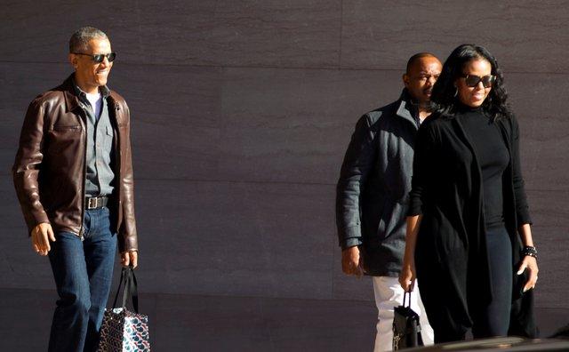 <p>Barack & Michelle Obama ( AP Photo/Jose Luis Magana)</p>