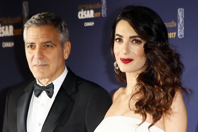 <p>George Clooney and Amal (AP Photo/Francois Mori)</p>