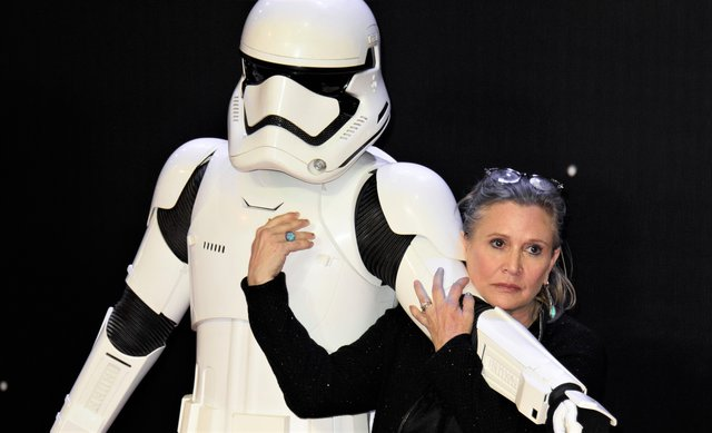<p>Carrie Fisher (Photo by Jonathan Short/Invision/AP)</p>