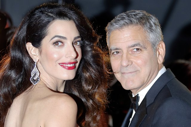 <p>George Clooney and Amal Clooney (AP Photo/Francois Mori)</p>
